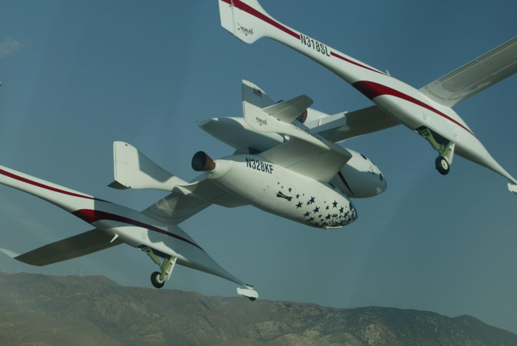 Lifted to launch altitude by White Knight, SpaceShipOne then dropped free and fired its rocket engine.