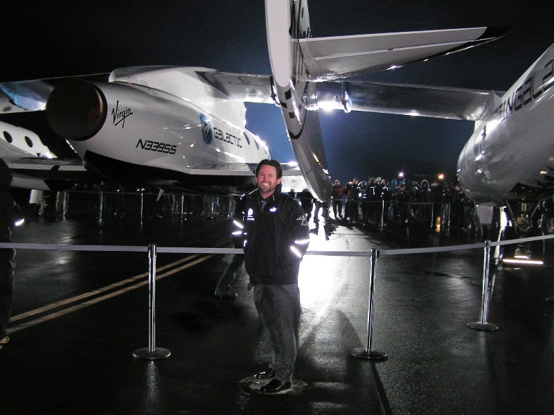 The aft view of SpaceShipTwo, with Dan Linehan standing by.